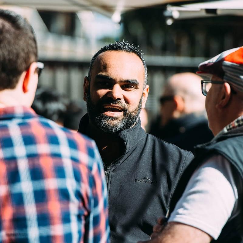 men chatting outside square